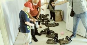 Soylu'dan otizmli çocuklara spor ayakkabı